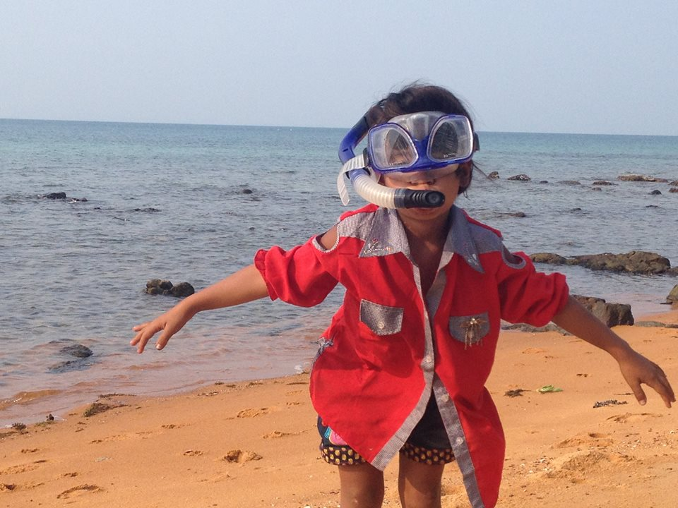 Cambodian girl with mask and snorkel