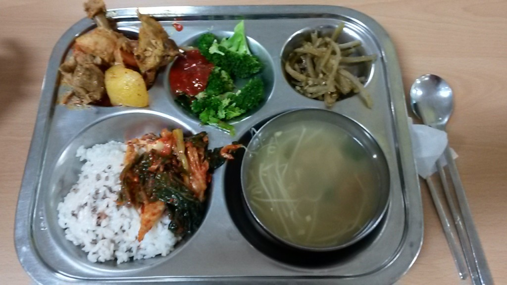 Monday's school lunch. Chicken with tiny bones, broccoli and sauce, a root of some kind, kimchi, rice, and soup.