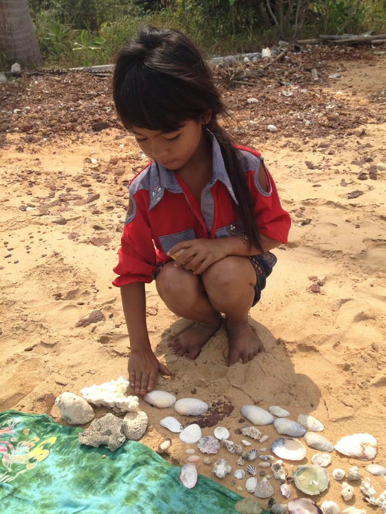 Cambodian girl with sea shell collection
