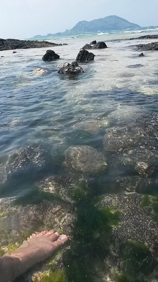 Feet in the water at hyeopjae beach, jeju island